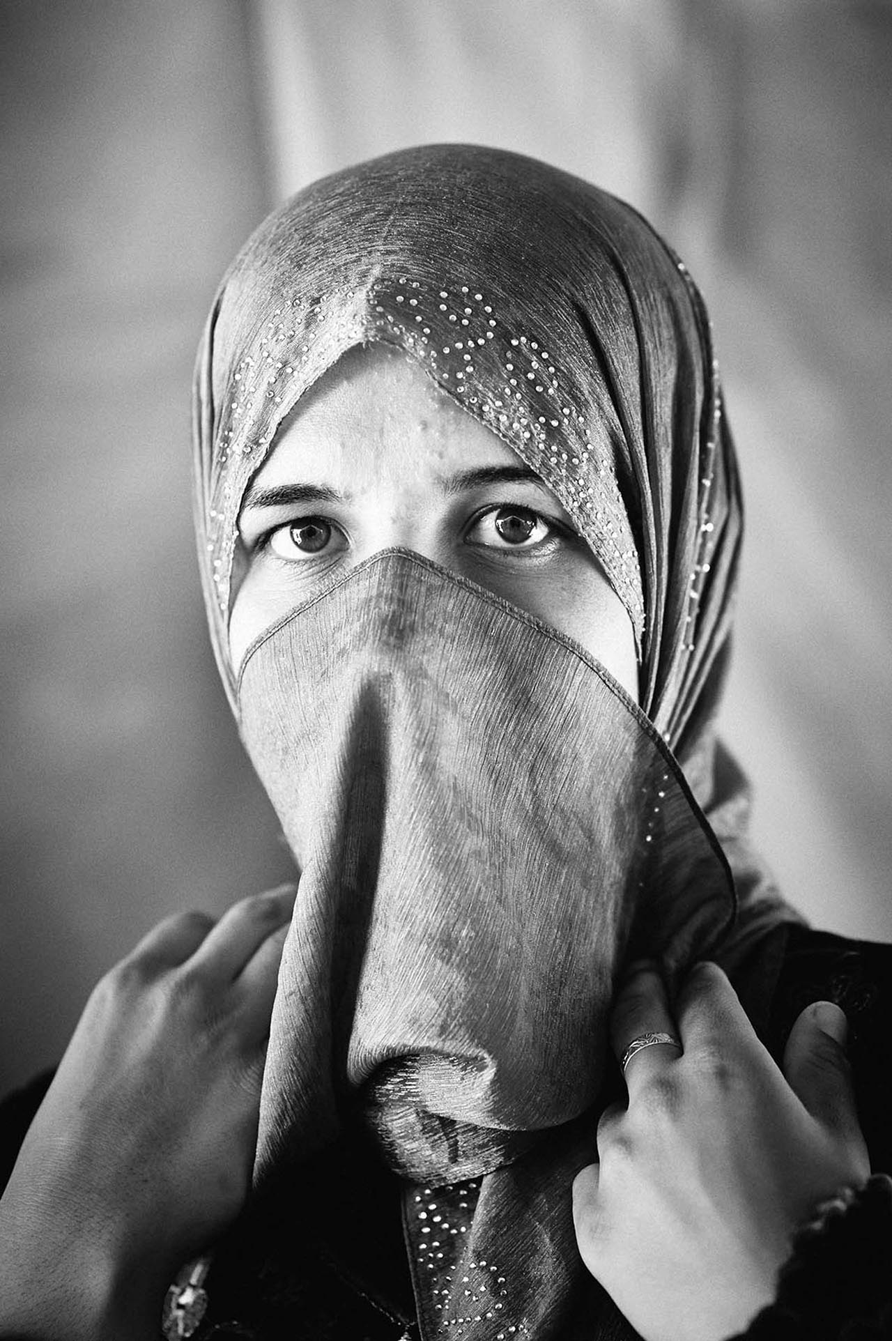 This young mother is in the waiting room of the French Hospital. She has just handed over her sick child to a French nurse who has walked back into the darkness of the operating theatres. She is not looking at the camera; she is looking somewhere beyond, perhaps to where her child is going. It is the look of fifty thousand women in Zaatari.