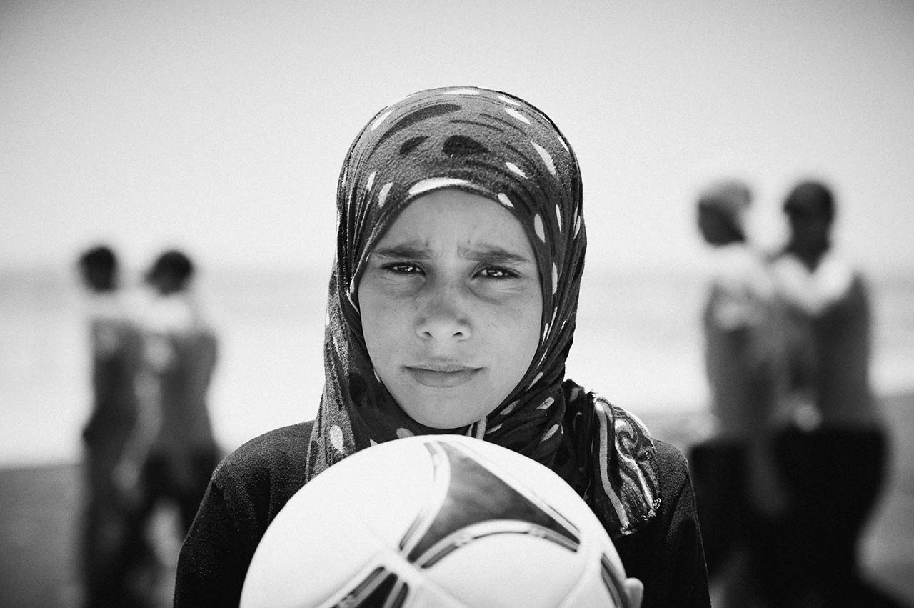 Some of the younger children in Zaatari play football. It relieves the boredom, and for a brief moment their predicament is forgotten. It swiftly returns as the players return to their tents.
