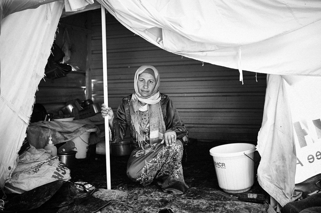 You can search for psychological insight, the mental anguish, the inner torment and you can find it in bucketfuls in Zaatari but then you turn a corner and you stop transfixed by the stark reality of what confronts you: a grotesque hybrid shack of aluminum and ripped tent. This is 'home' to a family, the paraphernalia of how they eat and survive stacked up on one side. A toy for a child. A bucket, evidence and reverse symbol of all that has not been supplied or provided. Only the mother 'guarding' this home provides, in her dignity, prove of human concern.