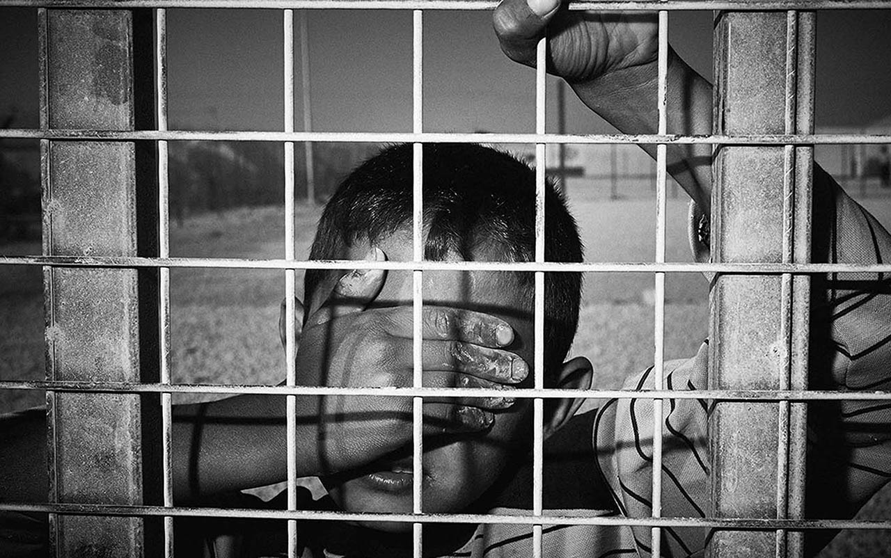 This is a shocking picture, not because it seems as if the young man is trapped like an animal, it is shocking because it expresses the psychological caging of a child's mind and the torment that this brings. The child can walk away from the fence, but he cannot check out from Hotel Zaatari.